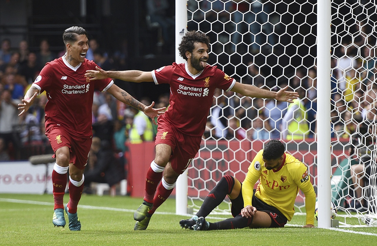 Liverpool's Mohamed Salah, center, celebrates scoring his side's third goal during the English Premier League soccer match at Vicarage Road, Watford, England, Saturday, August 12, 2017.