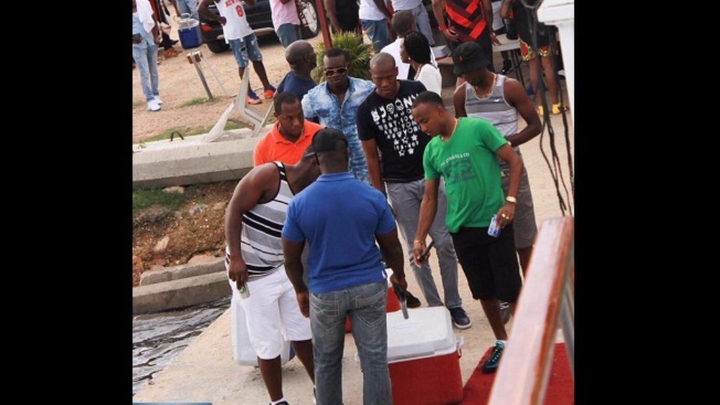 Patrons line Chaguaramas jetty to board party boat.