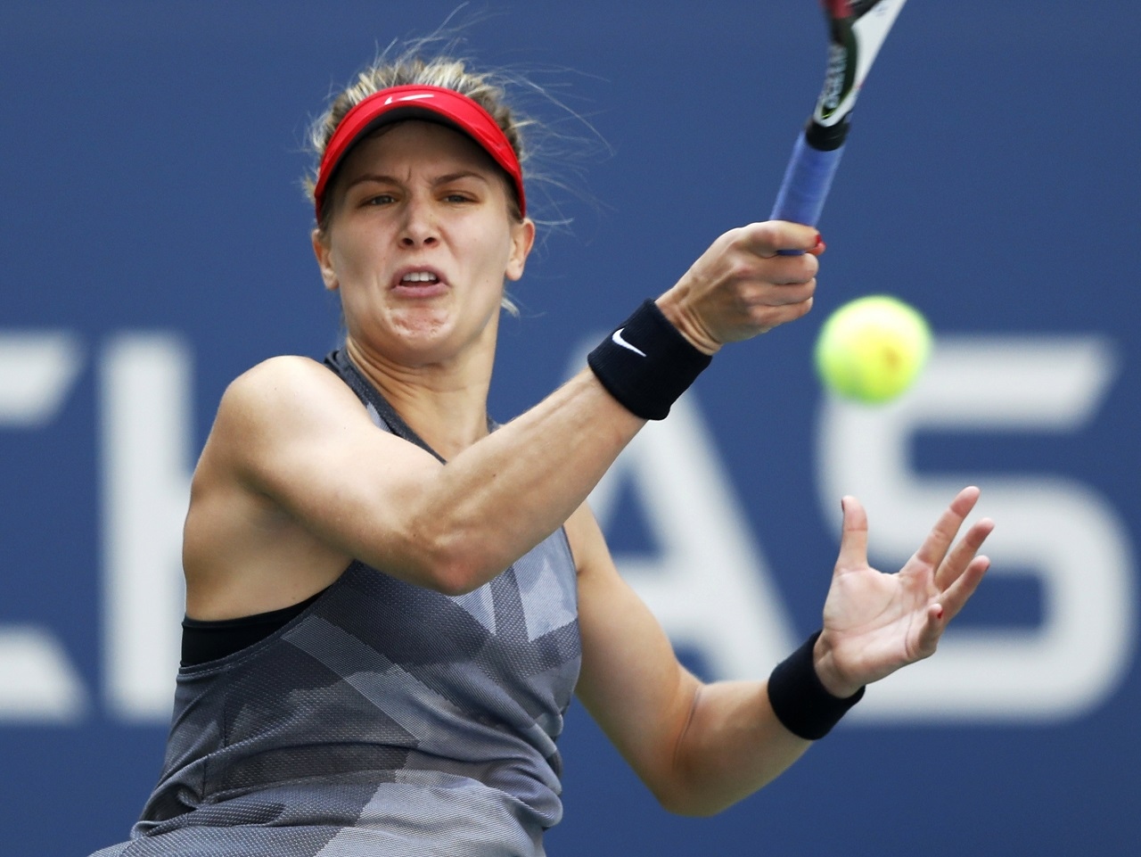 Eugenie Bouchard, of Canada, returns a shot from Evgeniya Rodina, of Russia, during the first round of the U.S. Open tennis tournament, Wednesday, Aug. 30, 2017, in New York.