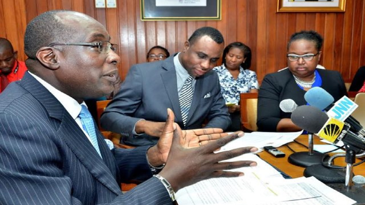 Education Minister Senator Ruel Reid (left), highlights a point while addressing a press conference at his National Heroes Circle offices on Friday. The conference was held to discuss the 2017 results of the CAPE and CSEC examinations. Others (from second left) are: Permanent Secretary, Dean-Roy Bernard; and Chief Education Officer, Dr Grace McLean. (PHOTO: JIS)