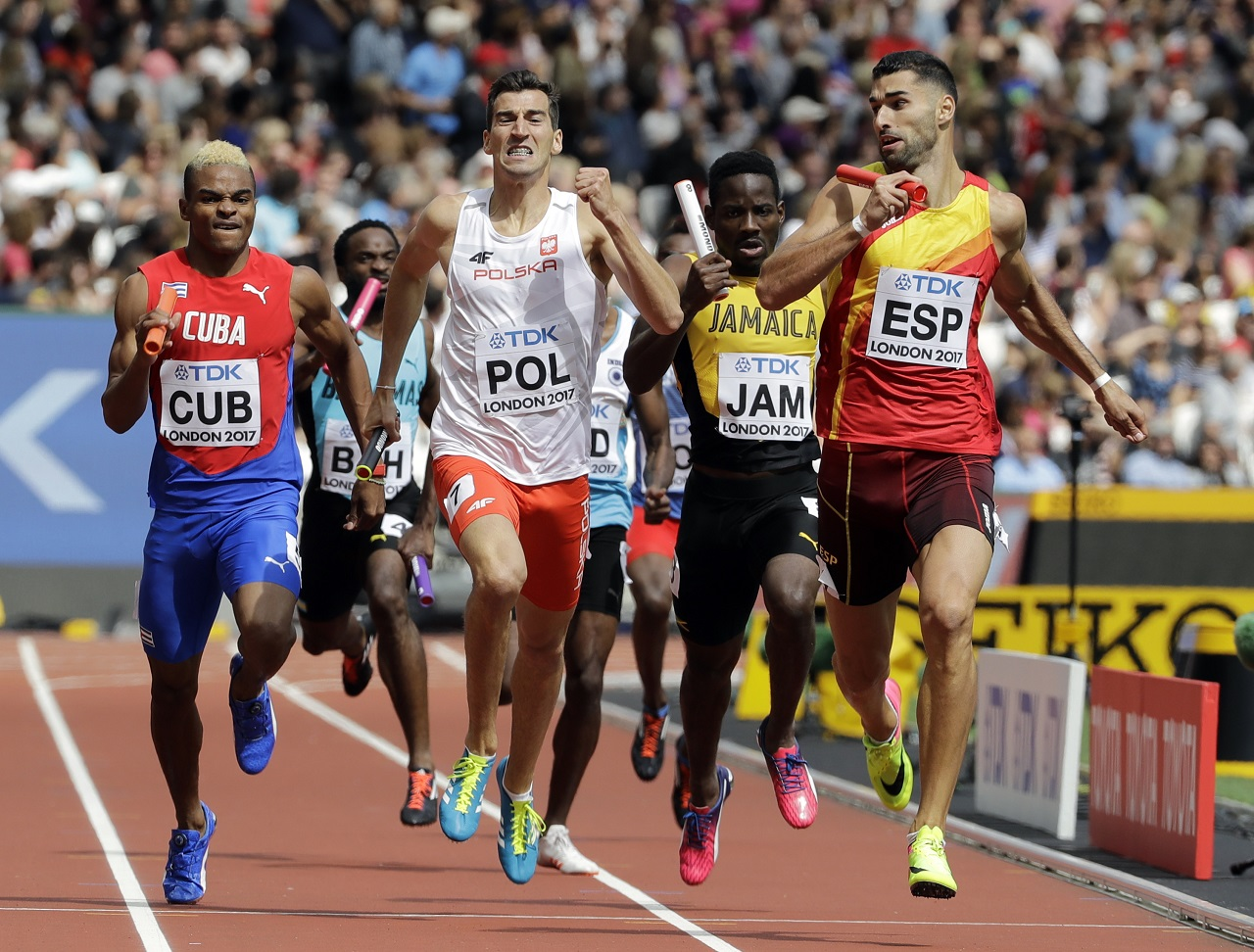 Jamaica's anchor leg runner Rusheen McDonald (yellow jersey) tries to get on terms as Spain's Samuel Garcia, right, anchors his team to win a Men's 4x400m relay heat.