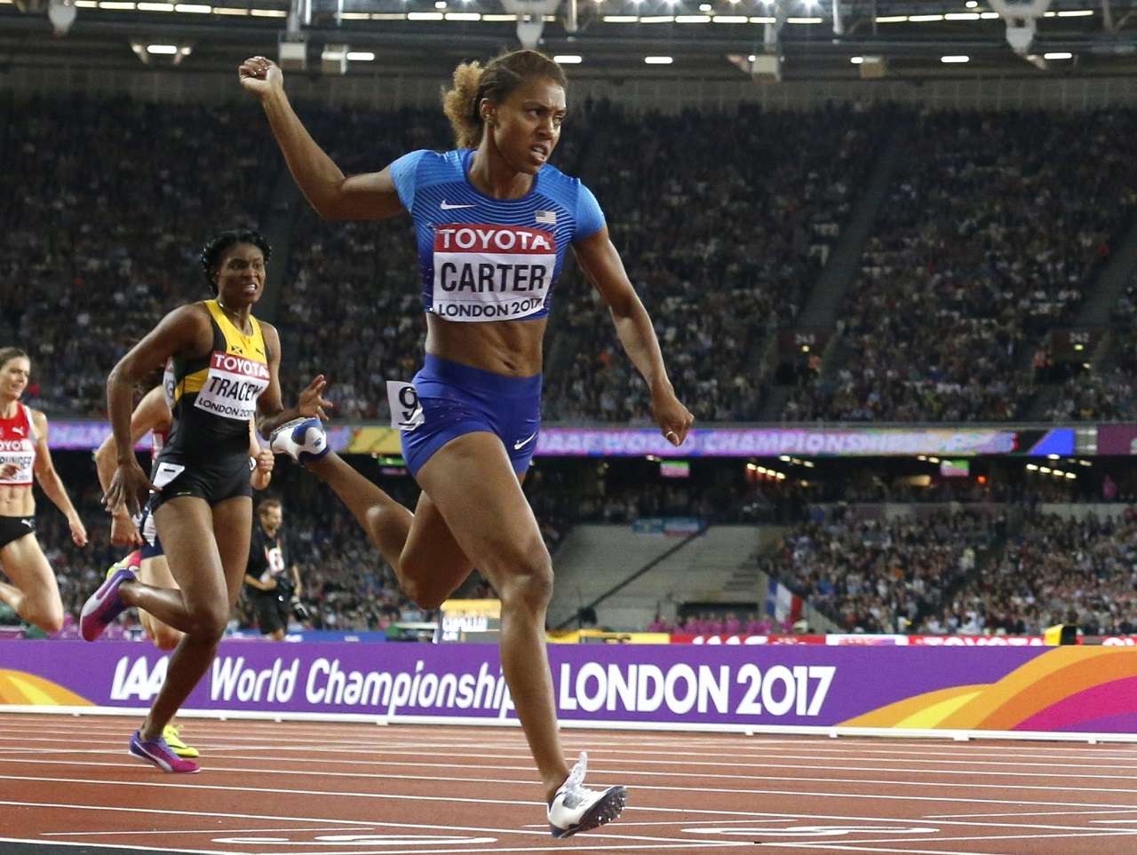 United States' Kori Carter crosses the line to win gold in the women's 400m hurdles final in London on Thursday. Jamaican Ristananna Tracey, behind, won the bronze.