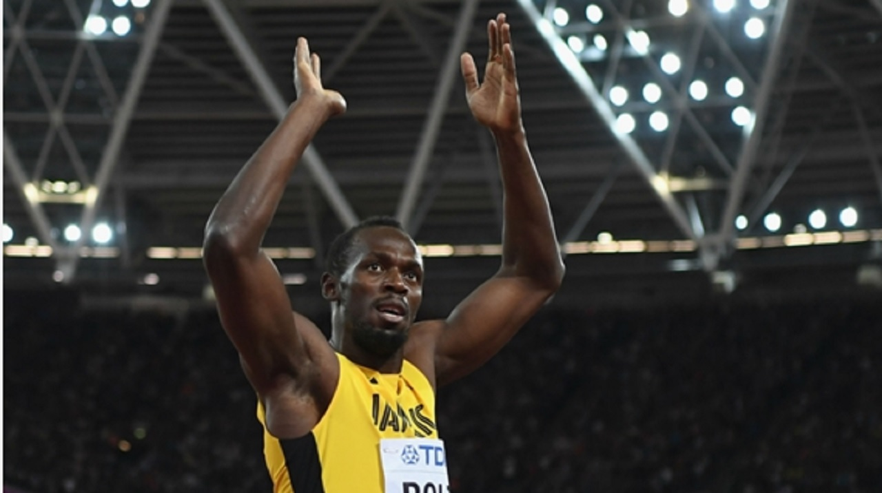 Usain Bolt takes the acclaim of the fans after finishing third in his final individual race.