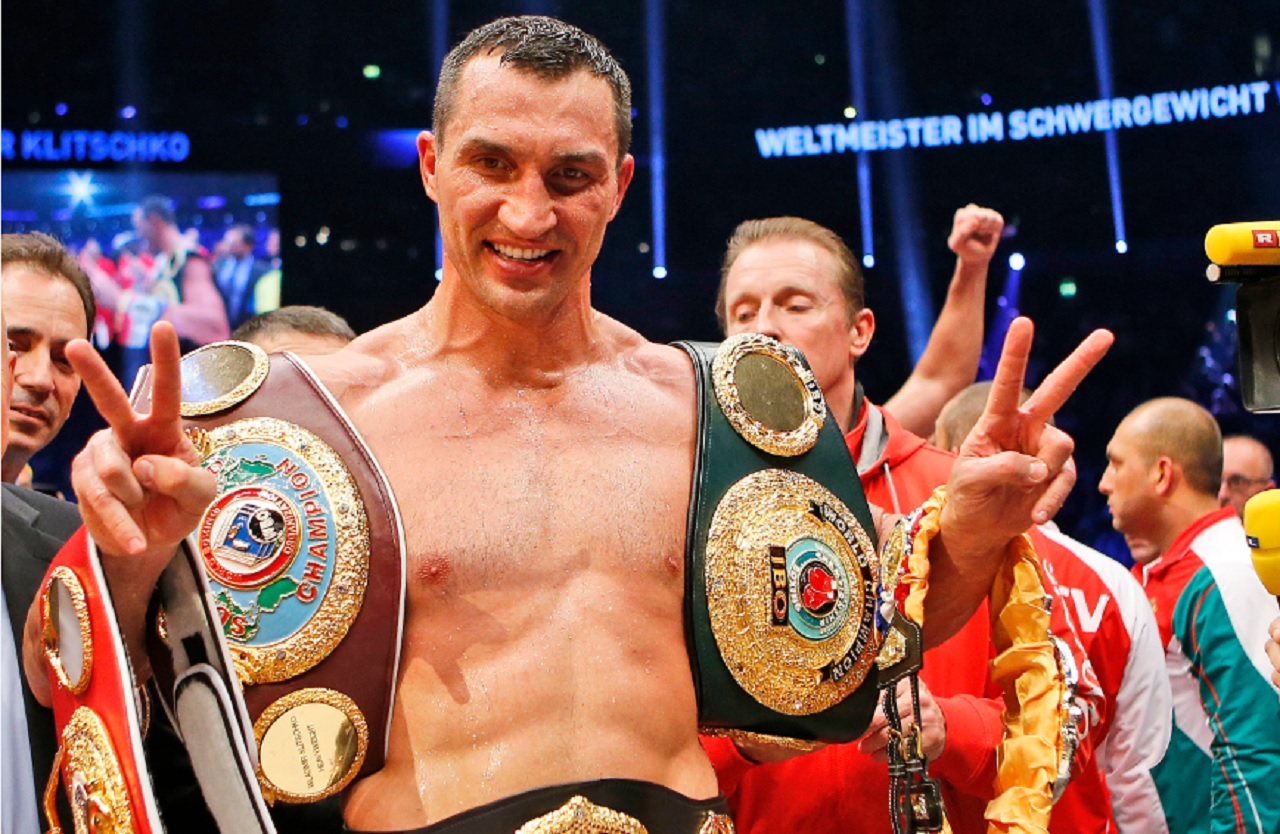 In this Nov. 15, 2014 file photo IBF, WBA, WBO and IBO champion Wladimir Klitschko from Ukraine celebrates after winning the IBF heavyweight world championships title bout against Bulgarian boxer Kubrat Pulev in Hamburg, Germany.