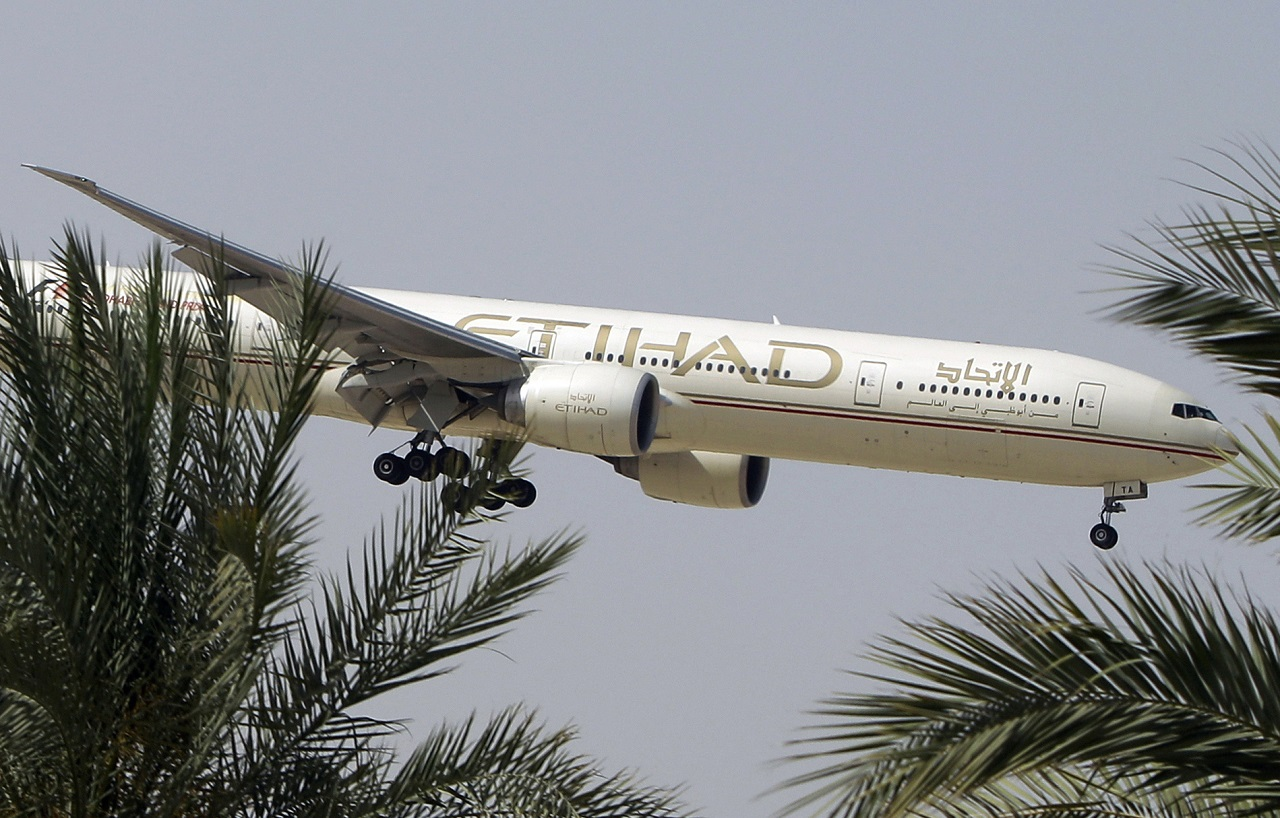In this Sunday, May 4, 2014 file photo, an Etihad Airways plane prepares to land in Abu Dhabi Airport, United Arab Emirates. The United Arab Emirates' national airline says it is working with Australian police in its investigation into an attempted airplane attack.
