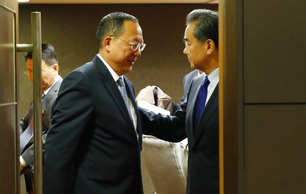 North Korean Foreign Minister Ri Yong Ho, center, bids farewell to his Chinese counterpart Wang Yi, right, following their bilateral meeting in the sidelines of the 50th ASEAN Foreign Ministers' Meeting and its Dialogue Partners Sunday, Aug. 6, 2017 in suburban Pasay city, south Manila, Philippines. (AP Photo/Bullit Marquez)