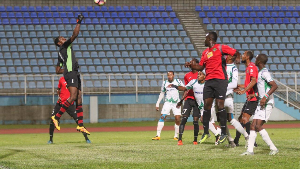 File photo: San Juan Jabloteh winger Nathan Lewis (#27) looks on as teammate and goalkeeper Javon Sample averts danger against W Connection during a 2016/17 Pro League clash. (TT Pro League)