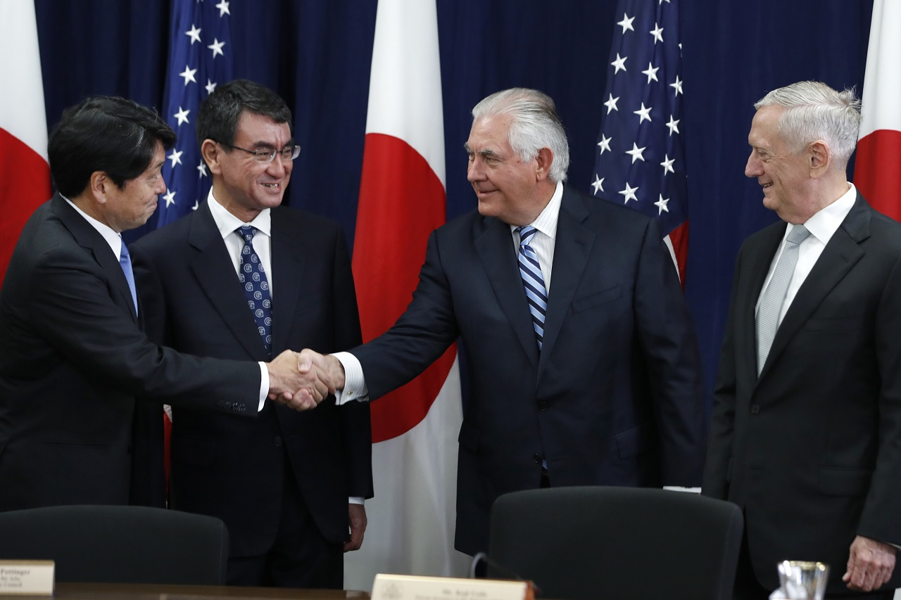 Japanese Defense Minister Itsunori Onodera, left, next to Japanese Foreign Minister Taro Kono, shakes hands with Secretary of State Rex Tillerson, next to Defense Secretary James Mattis, at the start of a Security Consultative Committee meeting, Thursday, Aug. 17, 2017, at the State Department in Washington.