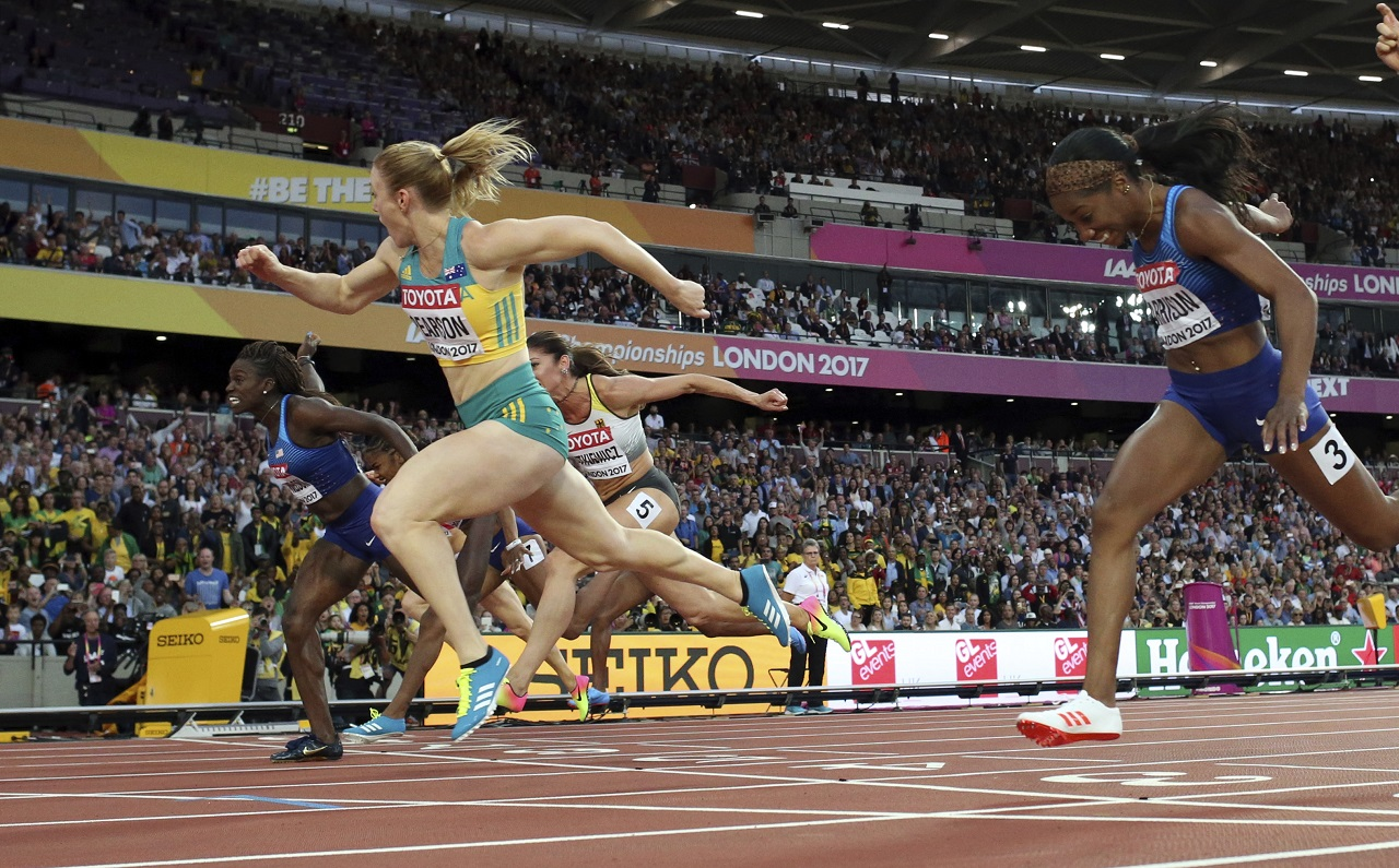 Australia's Sally Pearson crosses the line to win the gold in the women's 100-meter hurdles final during the World Athletics Championships in London Saturday, Aug. 12, 2017.