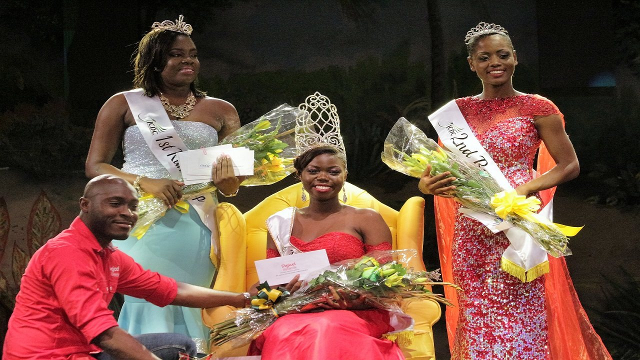 Miss Jamaica Festival Queen winner DainaLyn Swaby  (seated) collects a prize from Digicel Foundation CEO Dane Richardson. Sharing in the occasion are first runner-up, Miss St Ann Nareesha Jackson, and second runner-up, Miss St Mary Ava-Gail Lindsay. (PHOTOS: Marlon Reid)