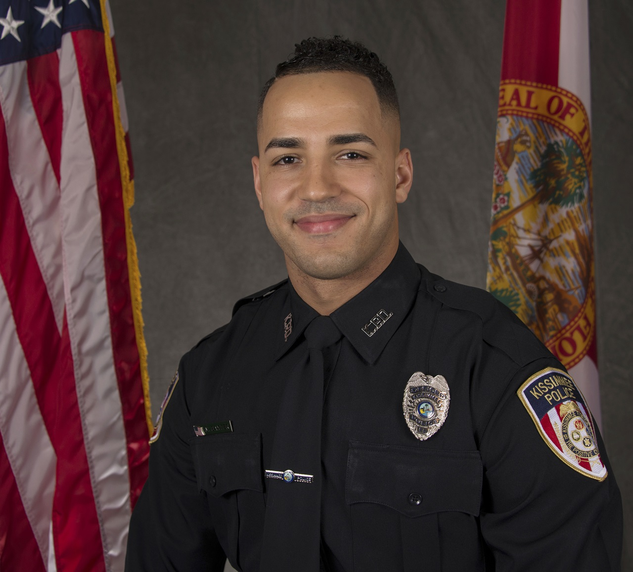 This undated photo from the Kissimmee Police Department shows Officer Matthew Baxter.
