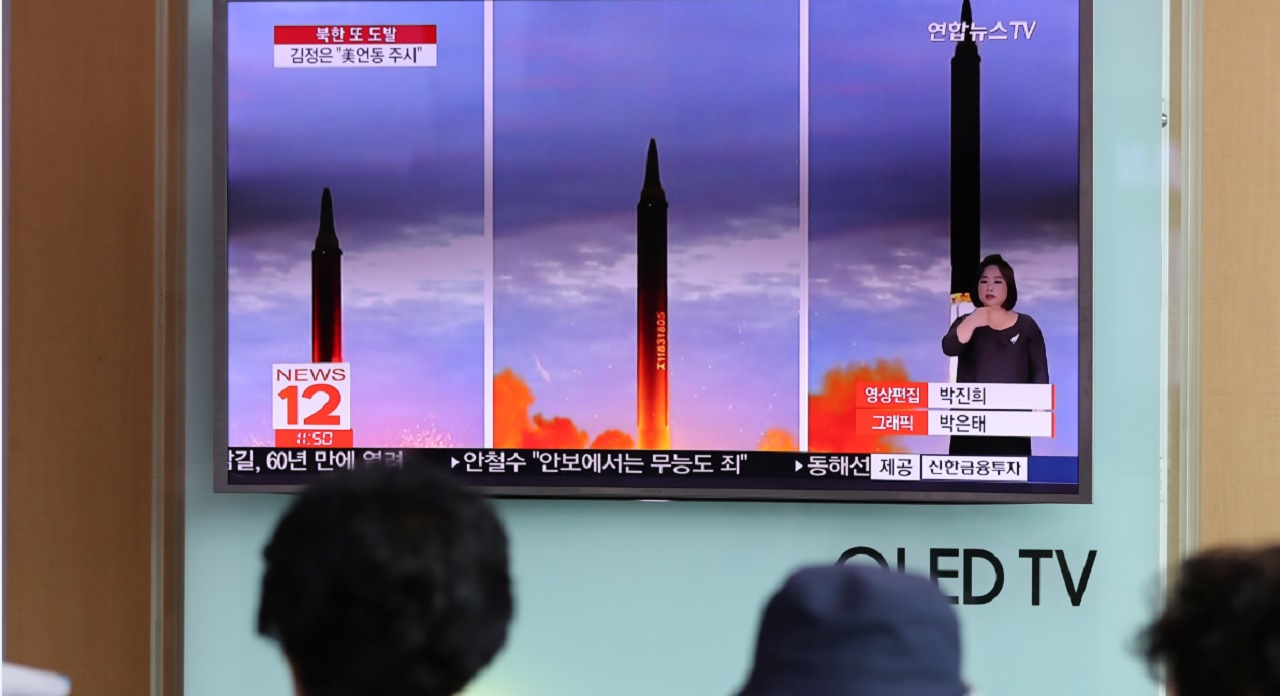 People watch a TV screen showing a local news program reporting about North Korea's missile launch at Seoul Train Station in Seoul, South Korea, Wednesday, Aug. 30, 2017.