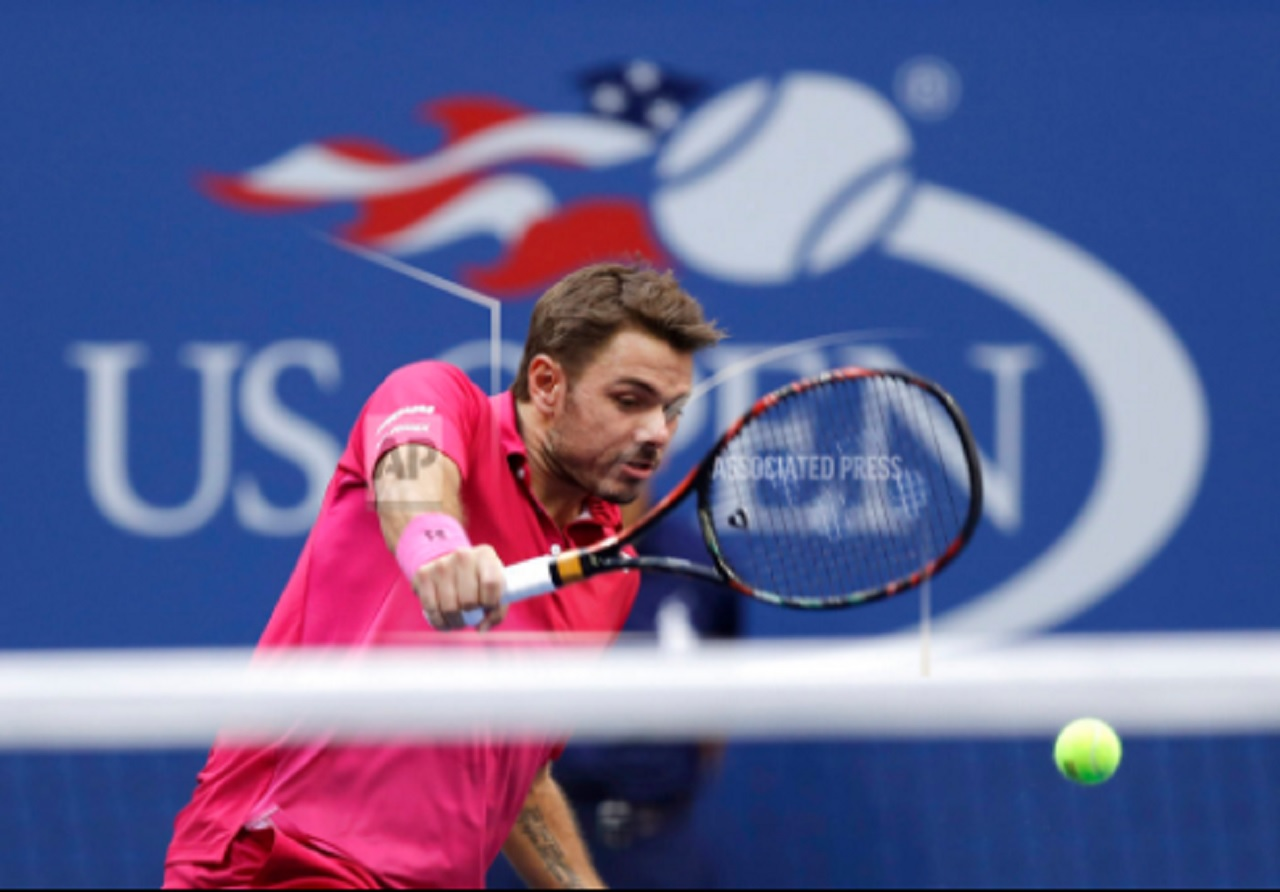 In this Sept. 11, 2016, file photo, Stan Wawrinka, of Switzerland, returns a shot to Novak Djokovic, of Serbia, during the men's singles final at the U.S. Open tennis tournament, in New York.