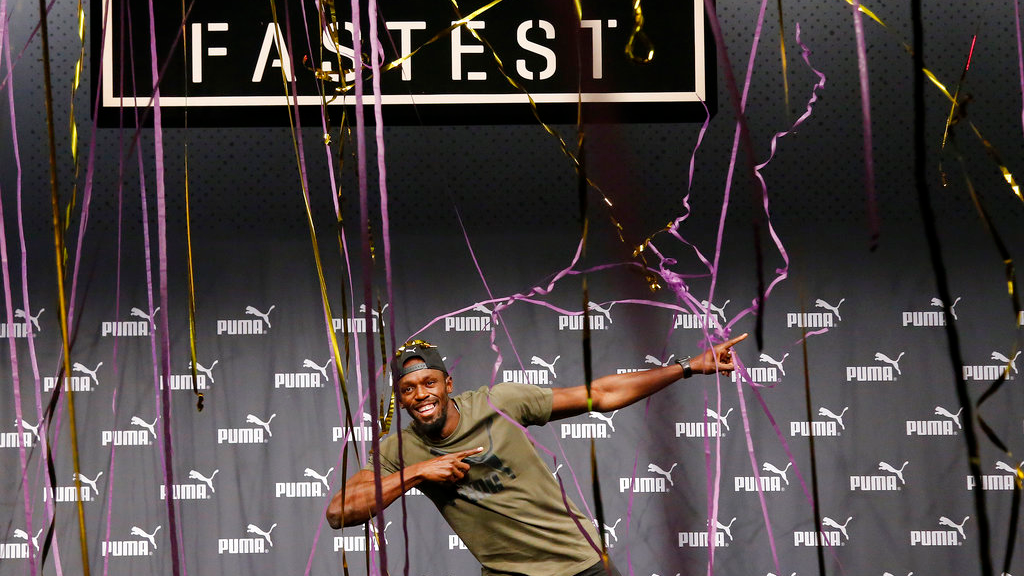 Jamaican athlete Usain Bolt celebrates after a press conference ahead of the World Athletics championships in London, Tuesday, Aug. 1, 2017. (AP Photo/Frank Augstein)