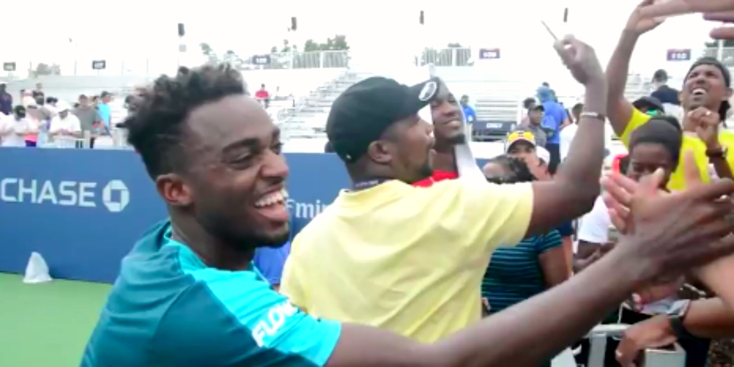 Darian King shaking hands with fans and friends at the stadium after winning the third set against Lukas Lacko.