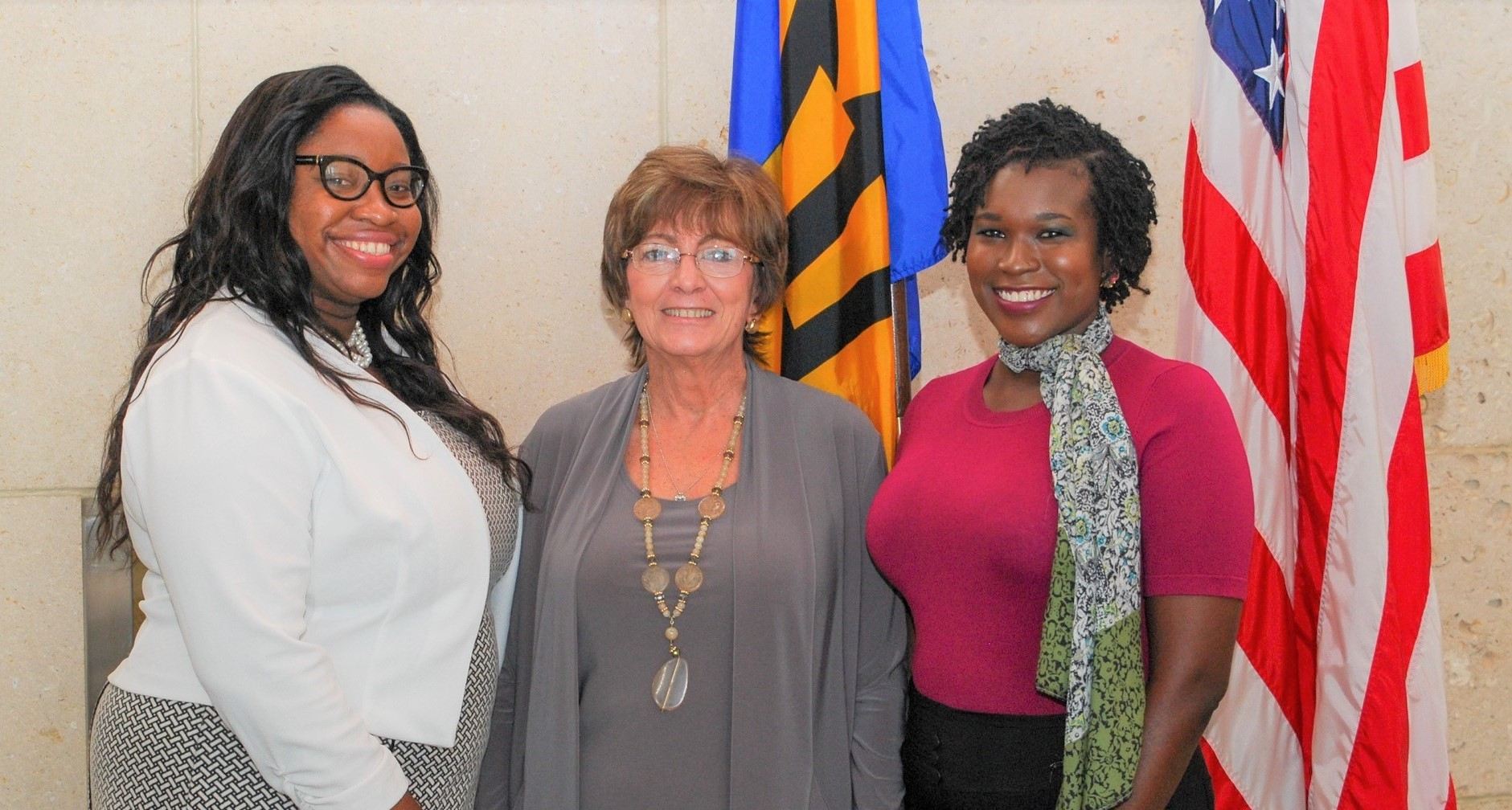 Fulbright Foreign Student scholar, Tamesha Duesbury (left), and Fulbright LASPAU recipient, Versia Harris (right) pose for a photo with U.S. Ambassador Linda Taglialatela at their pre-departure briefing. (PHOTO: US Embassy)