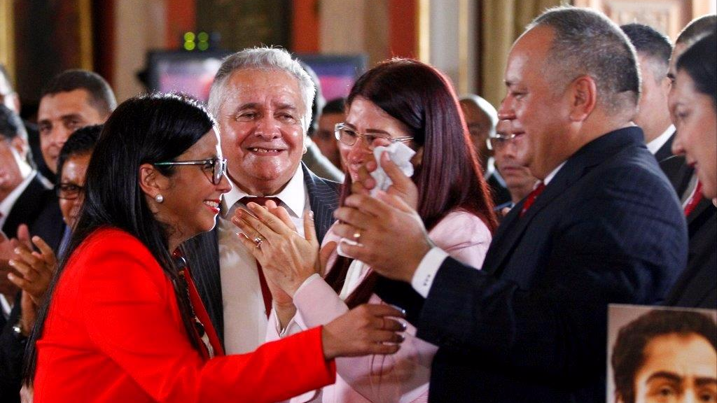 The President of Venezuela's Constituent Assembly, Delcy Rodriguez, left, is congratulated by Diosdado Cabello, right, after their swearing in ceremony, inside Venezuela's National Assembly, in Caracas, Venezuela, Friday, Aug. 4, 2017. Venezuelan President Nicolas Maduro is heading toward a showdown with his political foes, after seating a loyalist assembly that will rewrite the country's constitution and hold powers that override all other government branches. (AP Photo/Ariana Cubillos)