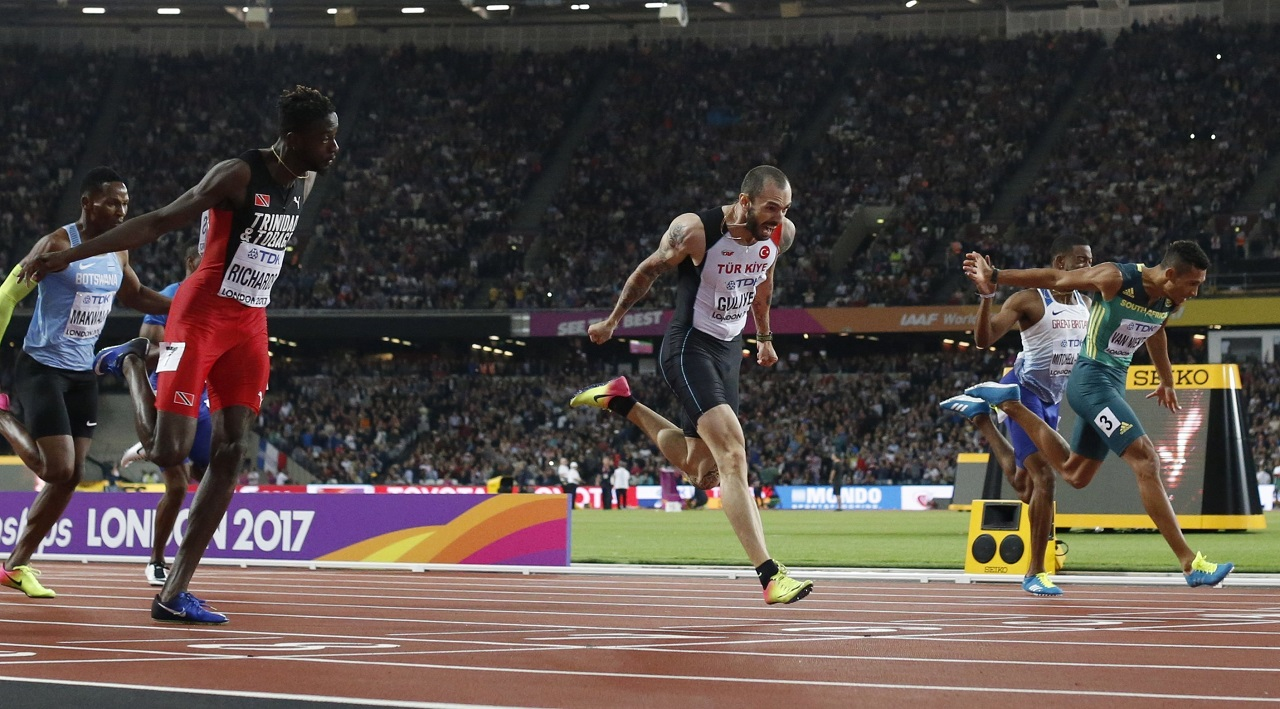 Turkey's Ramil Guliyev, center, crosses the line to win the gold in the men's 400-meter final during the World Athletics Championships in London Thursday, Aug. 10, 2017.