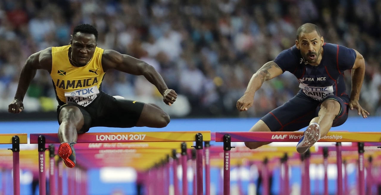 Jamaica's Omar Mcleod, left, and France's Garfield Darien compete in a Men's 110m hurdles semifinal during the World Athletics Championships in London Sunday, Aug. 6, 2017.