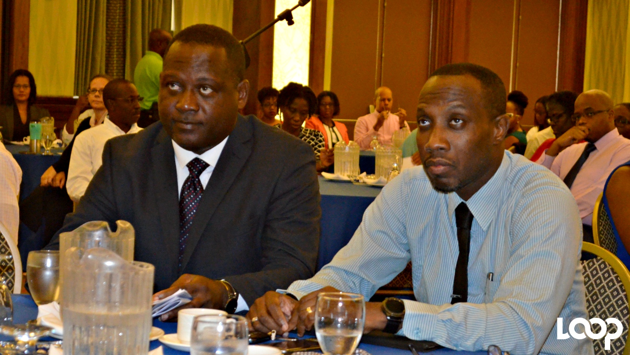 Minister of International Business, Donville Inniss and recently appointed Director of International Business, Kevin Hunte.