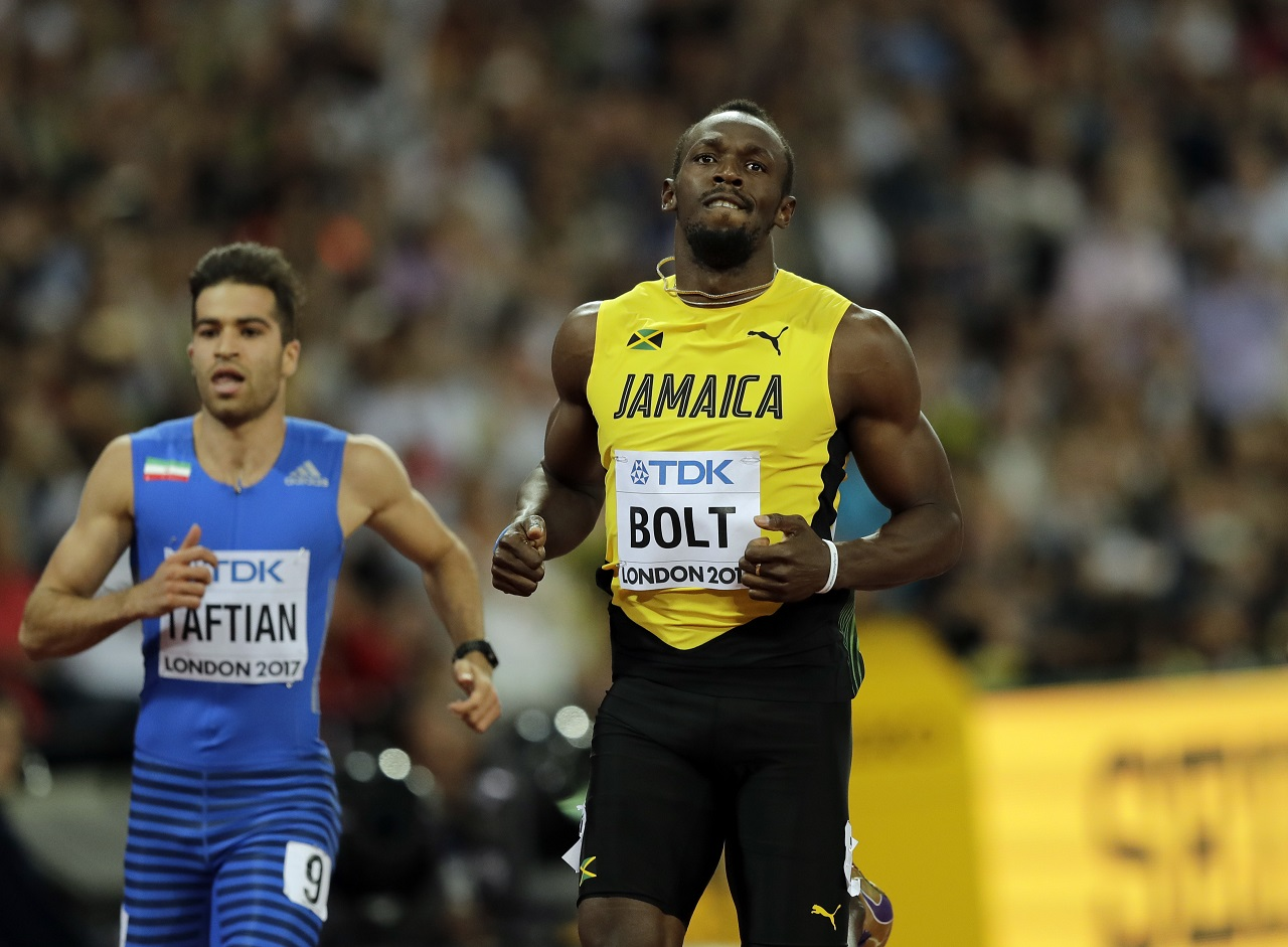 Jamaica's Usain Bolt competes in a men's 100-metre heat during the World Athletics Championships in London Friday, Aug. 4, 2017.