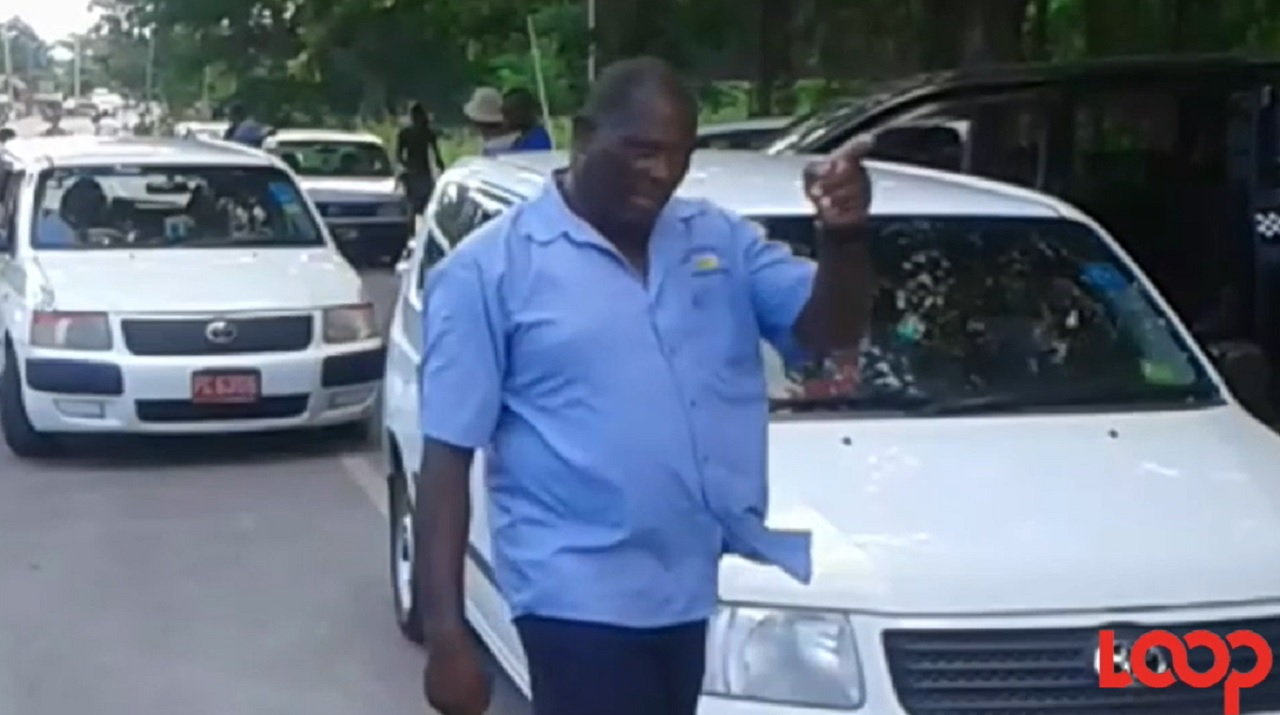 A taxi operator points to the Negril Transportation Centre, which 'cabbies' claim is in a deplorable state.