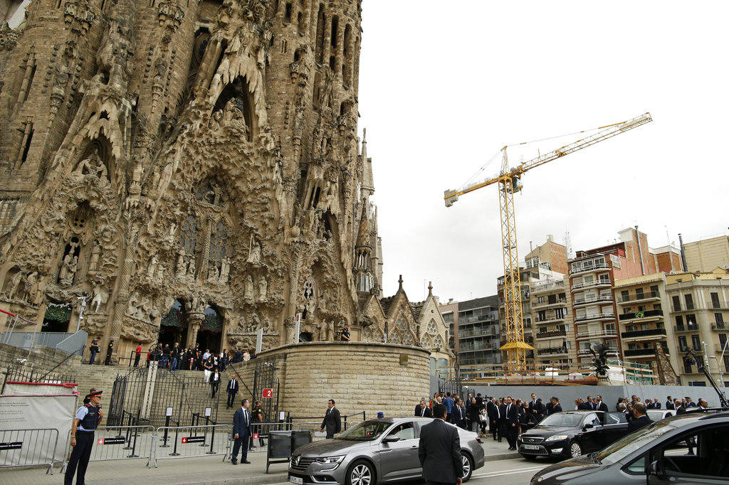 Dignitaries leave after a solemn Mass at Barcelona's Sagrada Familia Basilica for the victims of the terror attacks that killed 14 people and wounded over 120 in Barcelona , Spain, Sunday, Aug. 20, 2017. (AP Photo/Manu Fernandez)