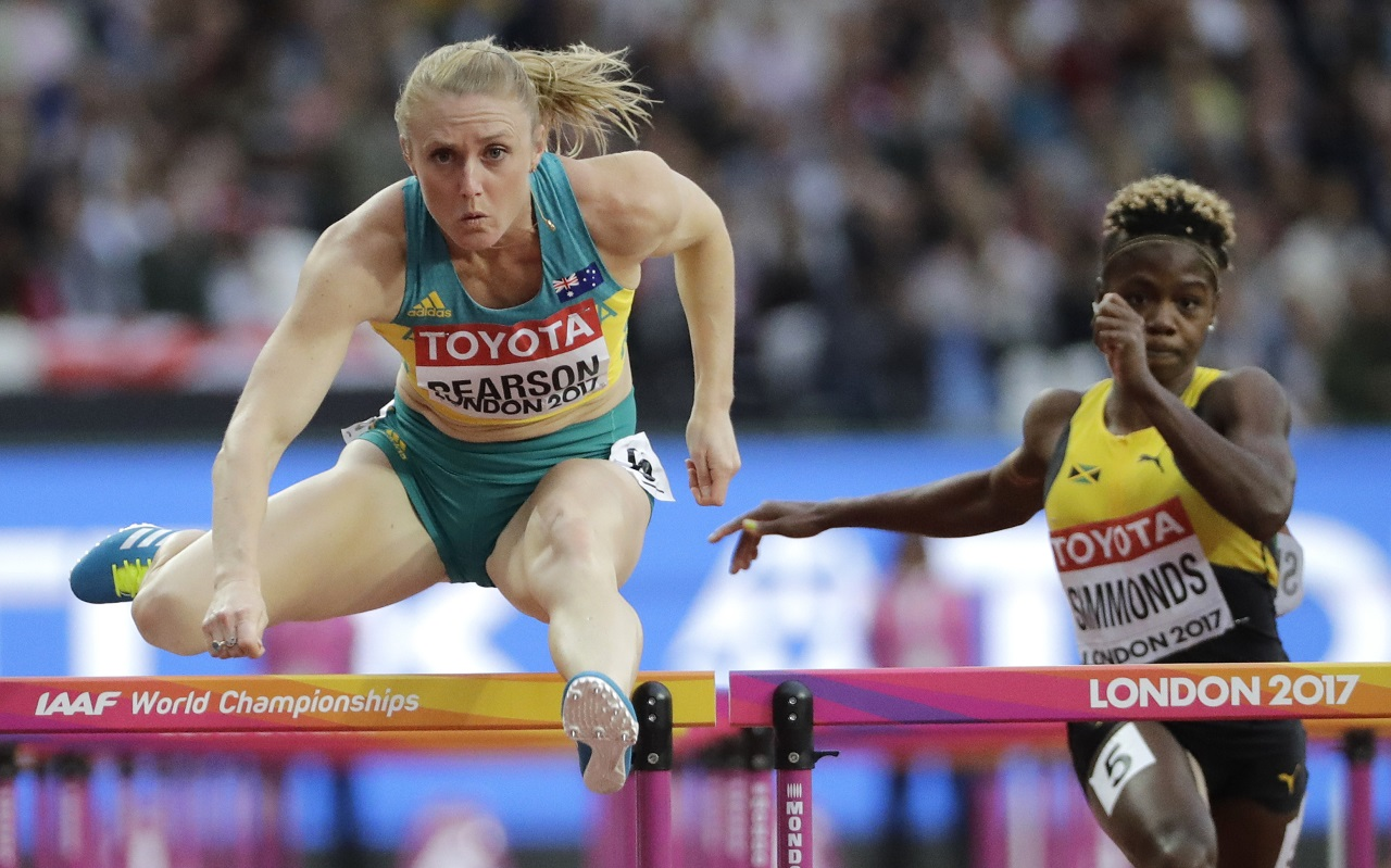 Australia's Sally Pearson in action on her way to winning a Women's 100m hurdles semifinal during the World Athletics Championships in London on Friday. Jamaican Megan Simmonds is behind.
