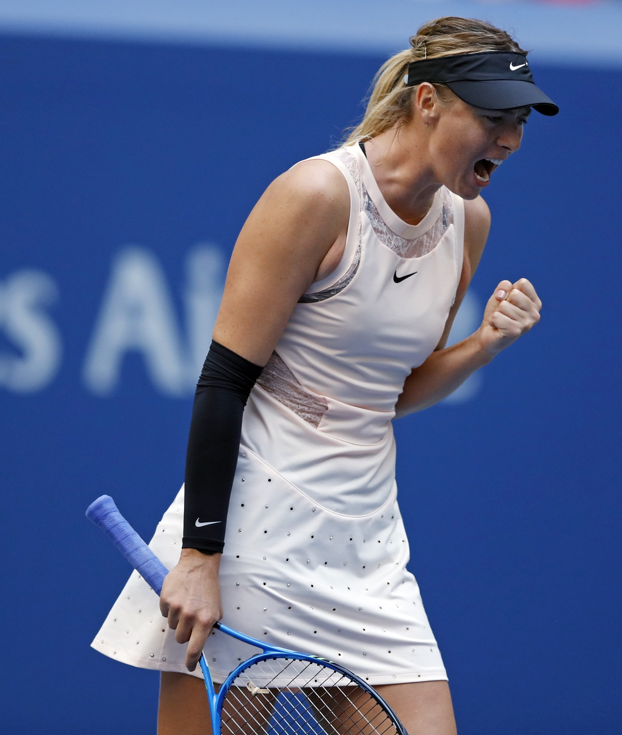 Maria Sharapova, of Russia, reacts after scoring a point against Timea Babos, of Hungary, during the second round of the U.S. Open tennis tournament, Wednesday, Aug. 30, 2017, in New York