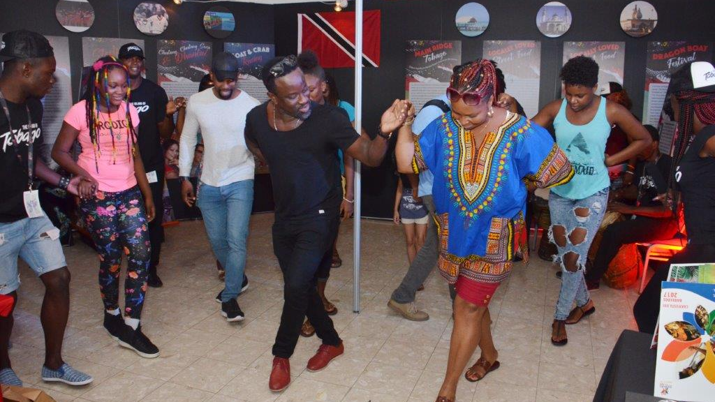 Tobago delegates demonstrate various traditional dancers to visitors to the Trinidad and Tobago booth at CARIFESTA XIII in Barbados.
