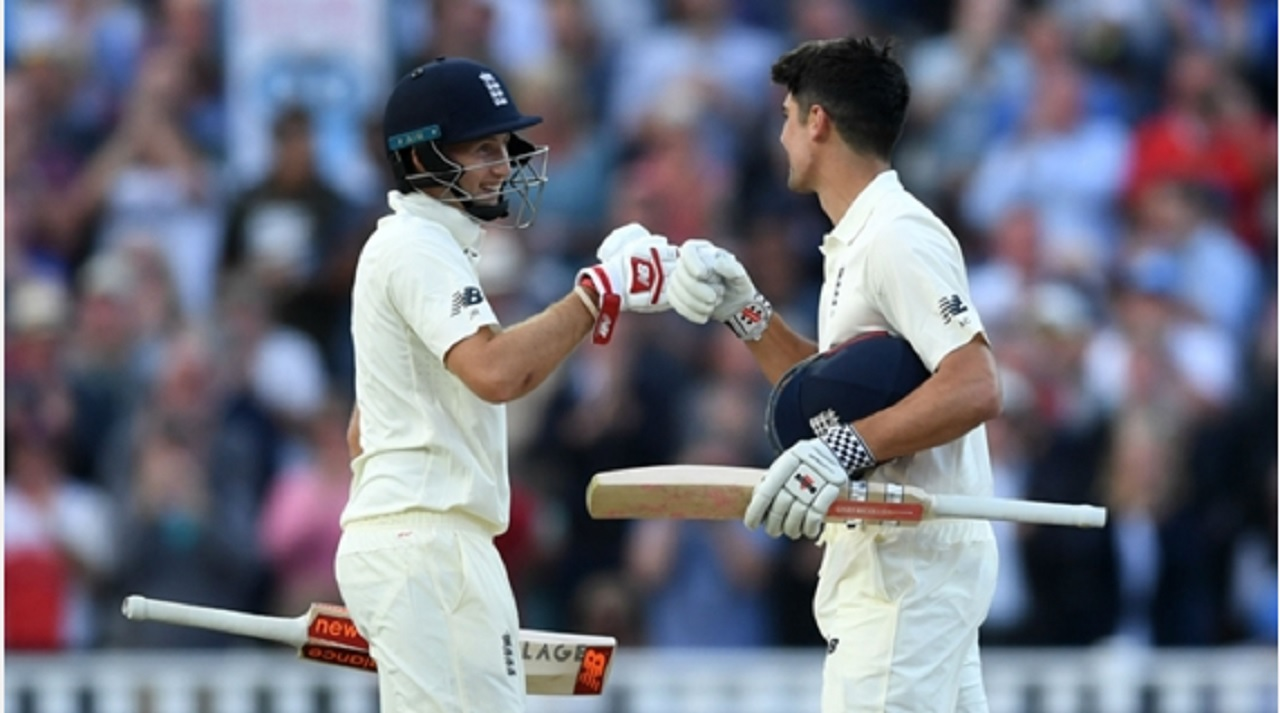 Joe Root congratulates fellow centurion Alastair Cook on his hundred.