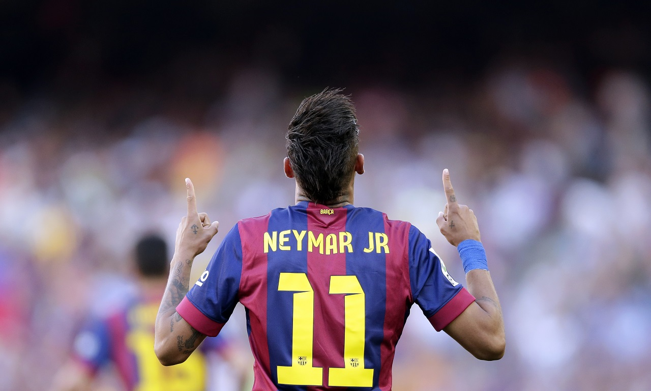 In this Saturday, May 9, 2015 file photo, FC Barcelona's Neymar celebrates after scoring against Real Sociedad during a Spanish La Liga soccer match at the Camp Nou stadium in Barcelona, Spain. Barcelona said Wednesday, Aug. 2, 2017.