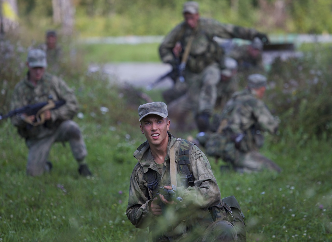 In this file photo taken on Wednesday, Aug. 2, 2017 Russian soldiers compete during a team's run at the Army Scout Masters competition, part of Army Games, outside Novosibirsk, 2900 km (some 1800 miles) east of Moscow, Russia.