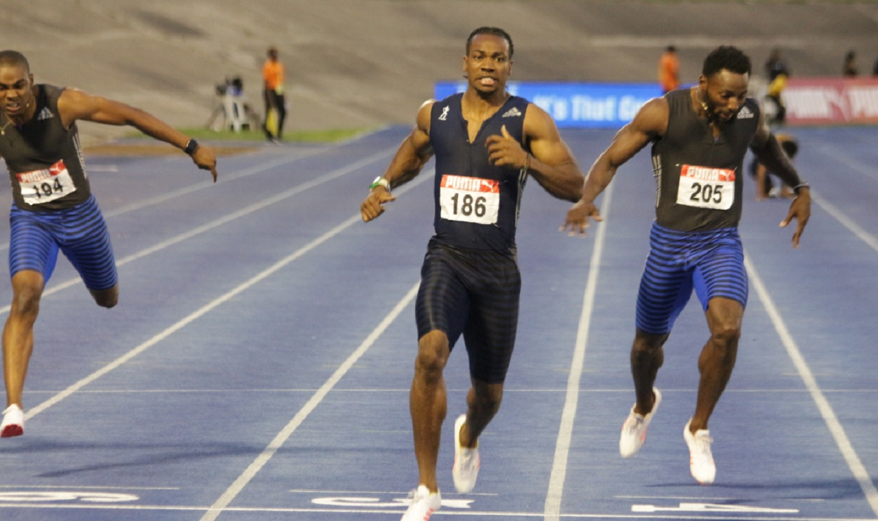 Yohan Blake (centre) of Racers Track Club wins the men's 200m at the National Senior Championships at the National Stadium on Sunday. Raheed Dwyer, right, finished second, while Warren Blake, left, got third.