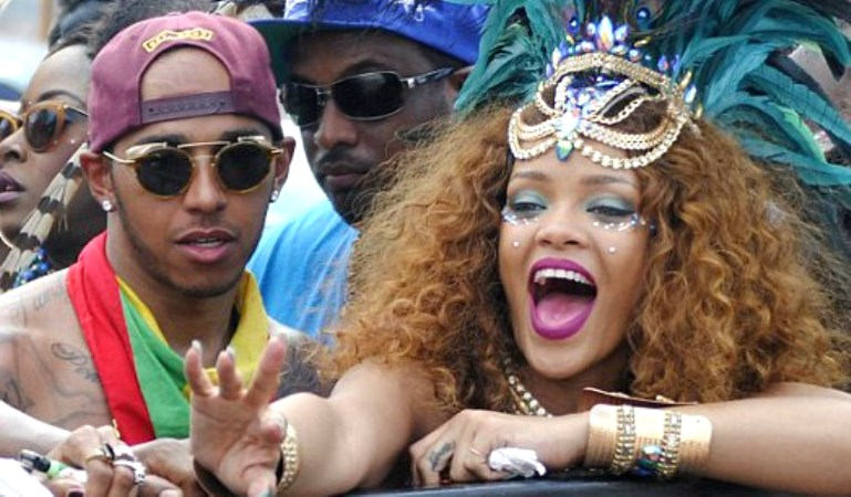 FILE - Rihanna and Lewis Hamilton on Kadooment Day in 2015.