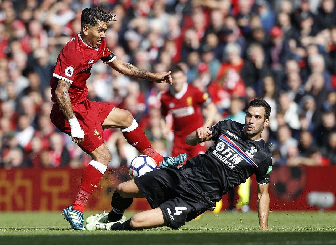 Liverpool's Roberto Firmino has a shot on goal blocked, during their English Premier League match against Crystal Palace, at Anfield, in Liverpool, England, Saturday Aug. 19, 2017.