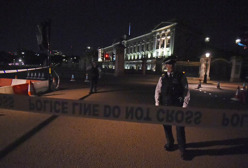 A police cordon outside Buckingham Palace where a man has been arrested after an incident, in London, Friday Aug. 25, 2017. (Lauren Hurley/PA via AP)