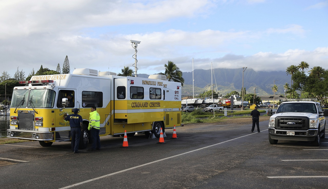 The Honolulu Fire Department Command Center is seen at a boat harbour, Wednesday, Aug. 16, 2017 in Haleiwa, Hawaii. An Army helicopter with five on board crashed several miles off Oahu's North Shore late Tuesday. Rescue crews are searching the waters early Wednesday.