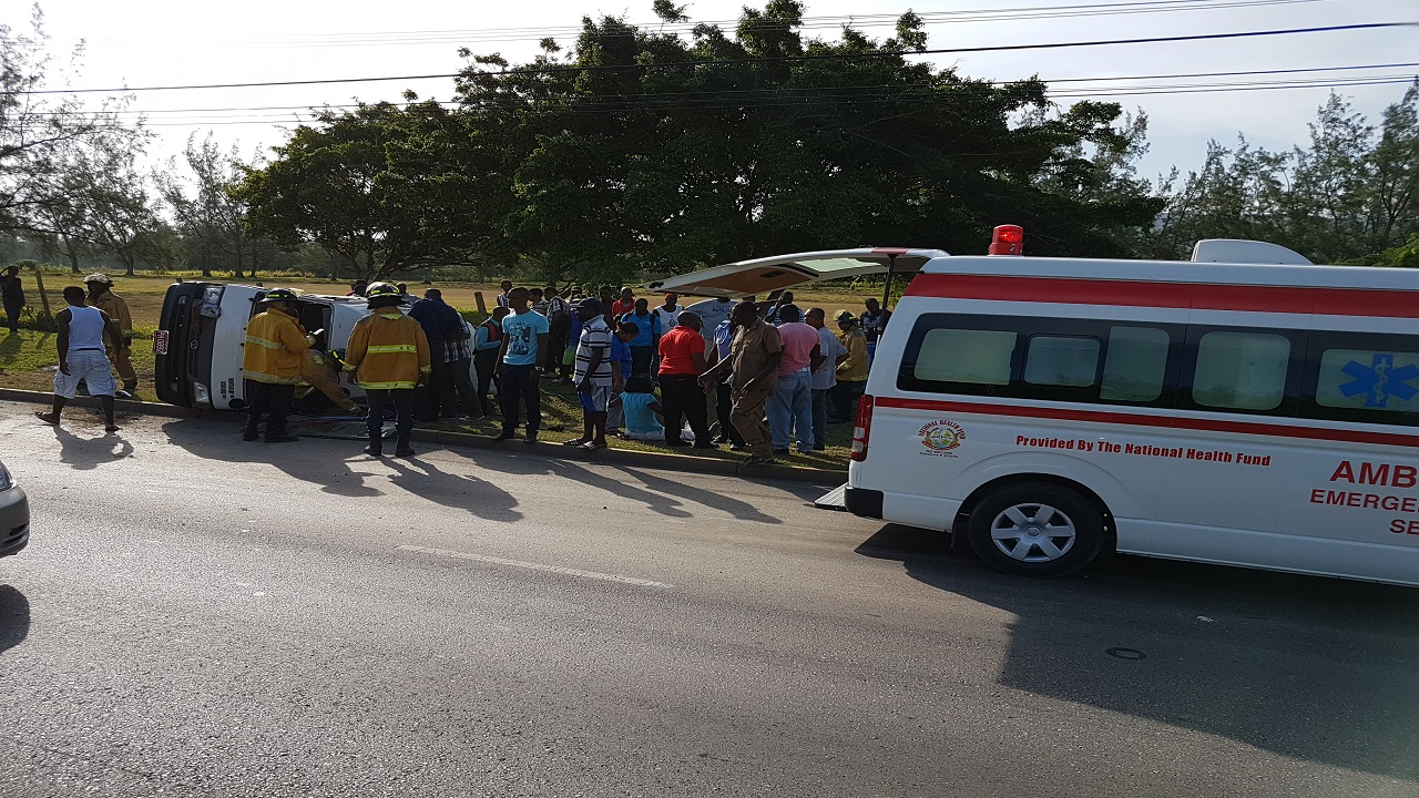 A photo of the accident scene after a bus overturned along the Rose Hall main road in St James.