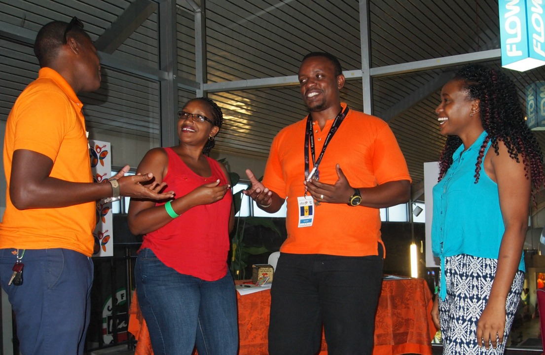 """Director and Producer of """"Hall"""", Rommel Hall (second from right), having a word with fellow film producer, Clish Gittens (far left) and viewers of the film."""