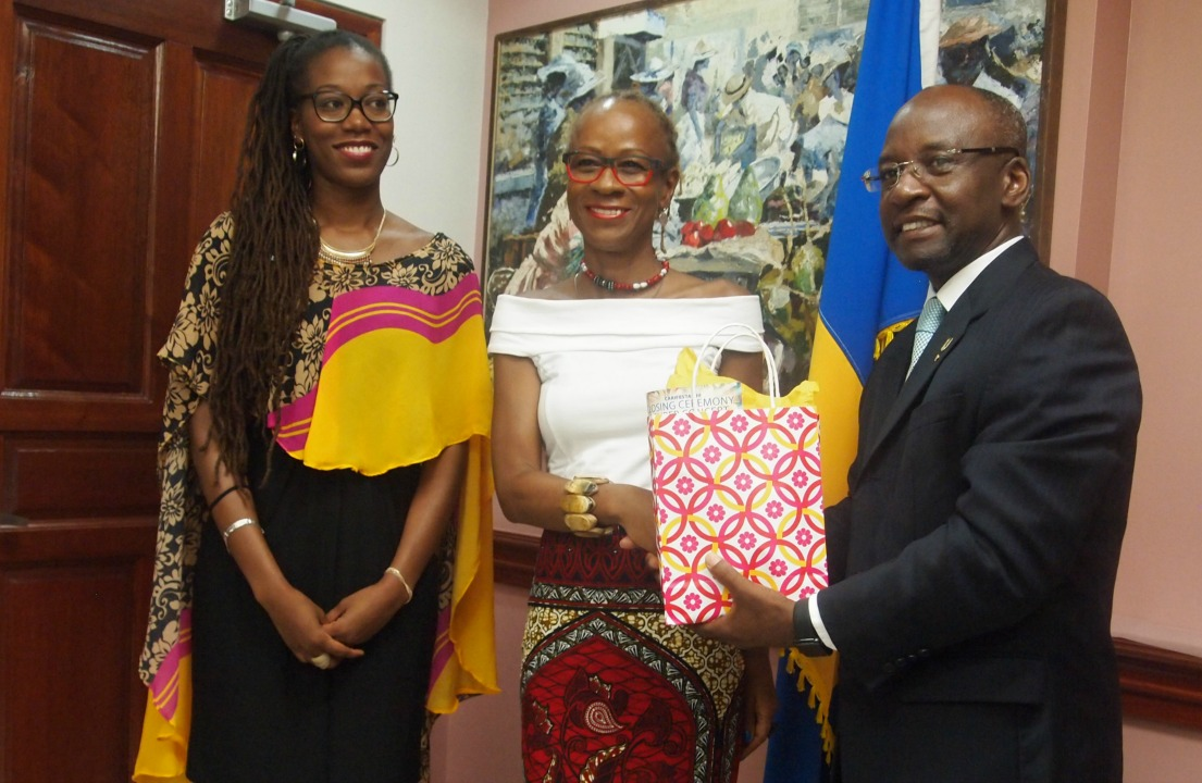 Director of Culture, Dominique Herbert (center) being presented with a token of appreciation from the Minister of Culture, Stephen Lashley as Regional Council of Guadeloupe, Audrey Galvani (left) looks on.