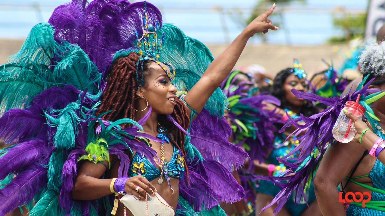 Xhosa Barbados revellers cross the stage at the National Stadium.