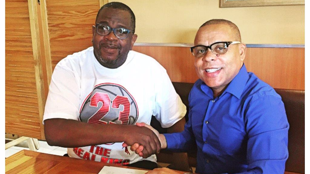 """Musical Director, Carlysle """"Juiceman"""" Roberts (left), shakes hands with Ian Pantin, the newly-appointed General Manager of D' All Starz (Courtesy: D' All Starz)"""