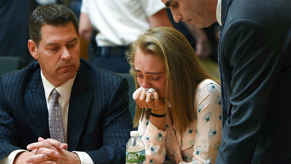 In this Friday, June 16, 2017, file photo, Michelle Carter cries while flanked by defense attorneys Joseph Cataldo, left, and Cory Madera, after being found guilty of involuntary manslaughter in the suicide of Conrad Roy III in Bristol Juvenile Court in Taunton, Mass. Juvenile Court Judge Lawrence Moniz will sentence Carter on Thursday, Aug. 3. (Glenn C.Silva/Fairhaven Neighborhood News, Pool, File)