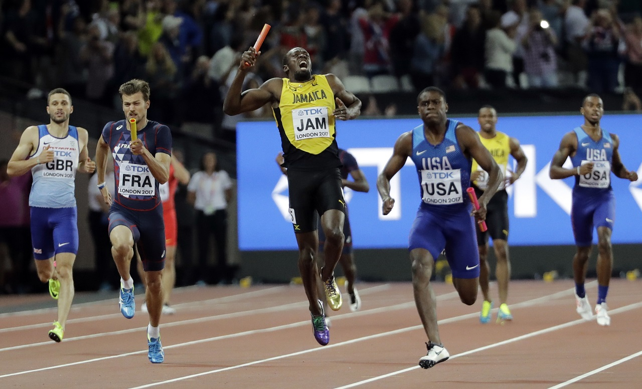 Jamaica's Usain Bolt, center, pulls up injured in the final of the Men's 4x100m relay during the World Athletics Championships in London Saturday, Aug. 12, 2017. At right is United States' Christian Coleman.