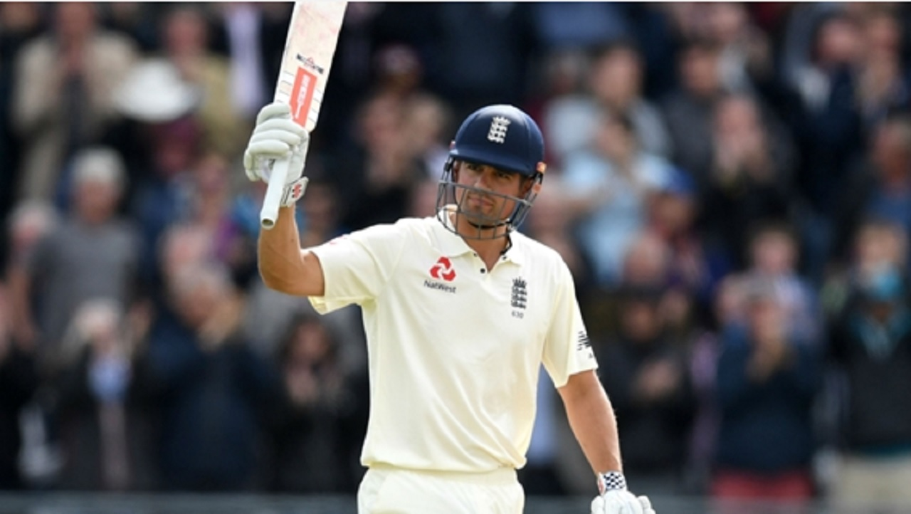 Alastair Cook raises his bat to the stands.
