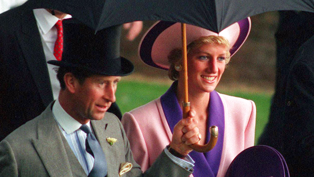 In this Wednesday, June 20, 1990 file photo, Britain's Princess Diana and Prince Charles, take shelter under an umbrella while attending the second day of the Royal Ascot horse race meet near London. A British television channel is broadcasting a new documentary on Princess Diana using video tapes in which she candidly discussed her marital problems and her strained relationship with the royal family.