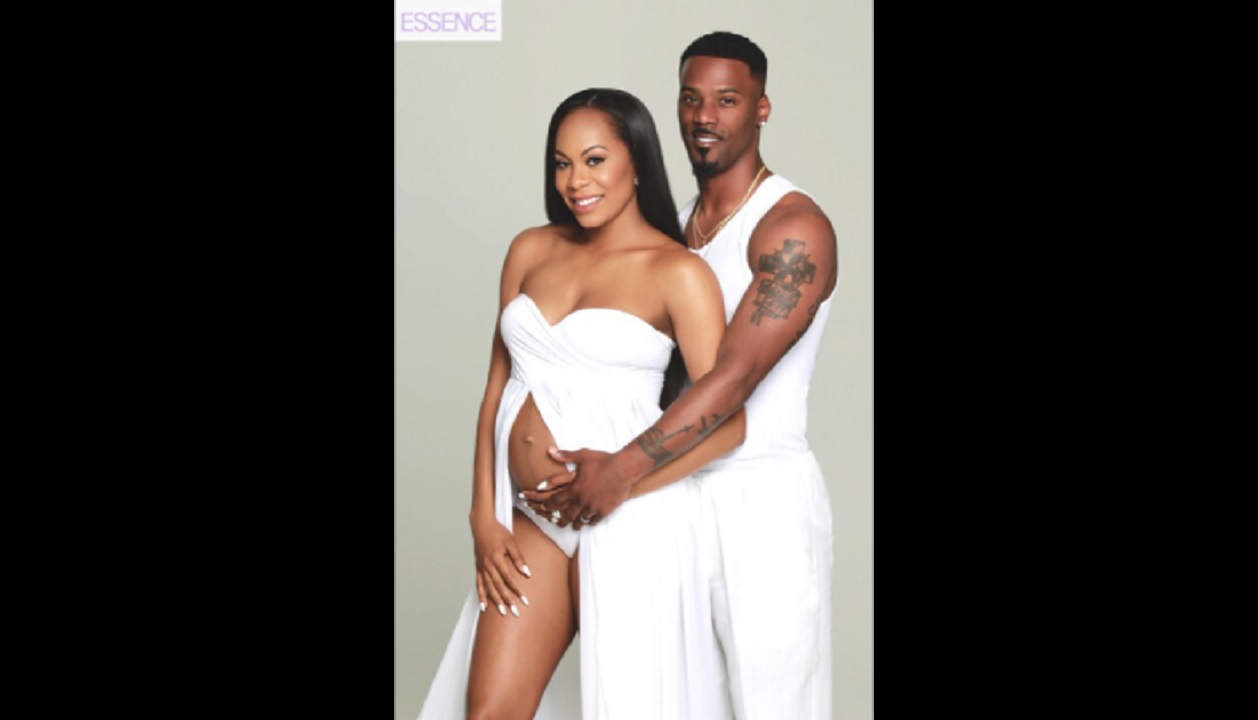 A pregnant Sanya Richards-Ross and her husband, Aaron, pose for Essence magazine earlier this year.
