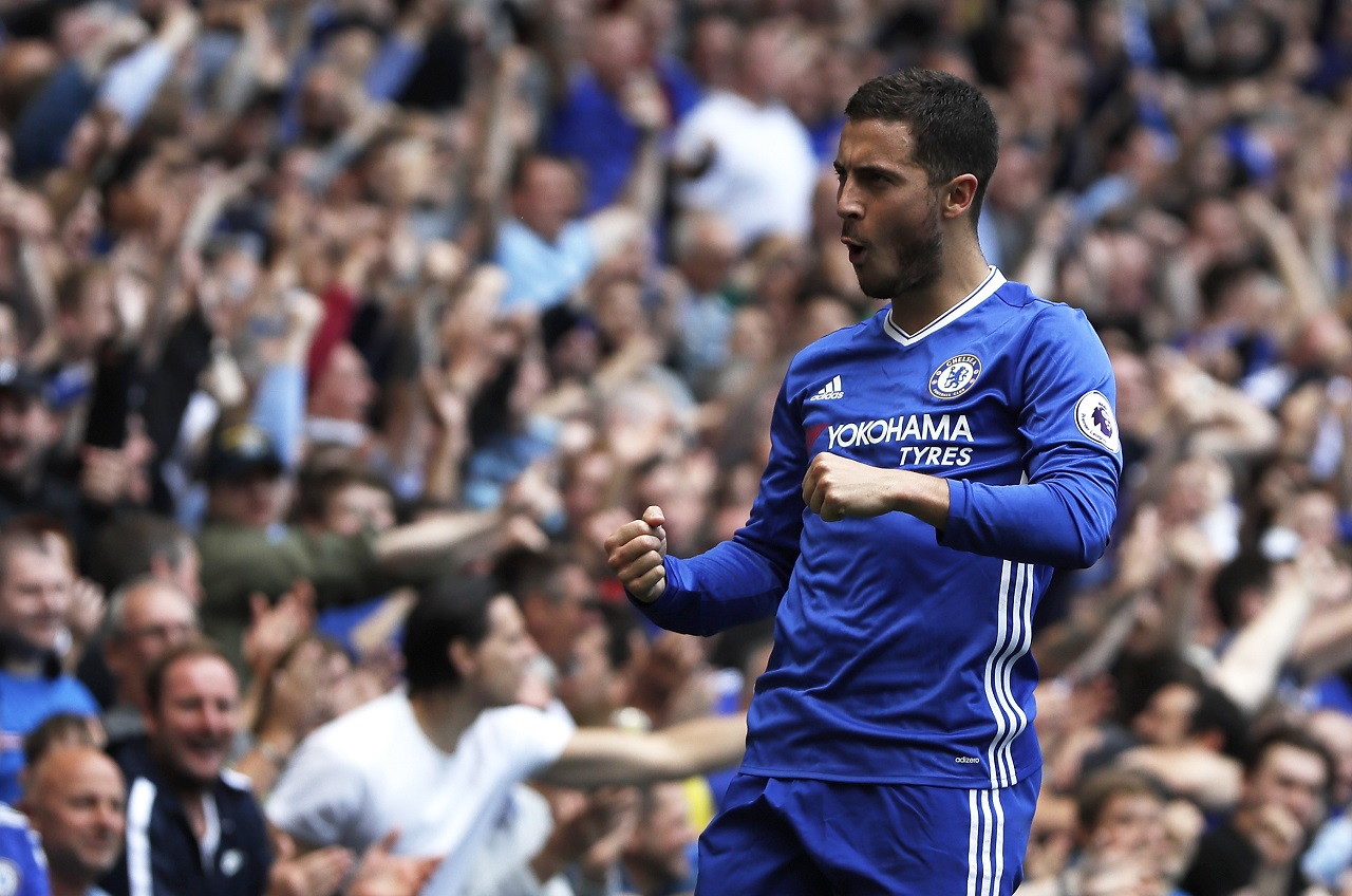In this Sunday, May 21, 2017 file photo, Chelsea's Eden Hazard celebrates after scoring his side's second goal during their English Premier League  match against Sunderland at Stamford Bridge stadium in London. Eden Hazard will be joined at Premier League champion Chelsea by his younger brother, Kylian.