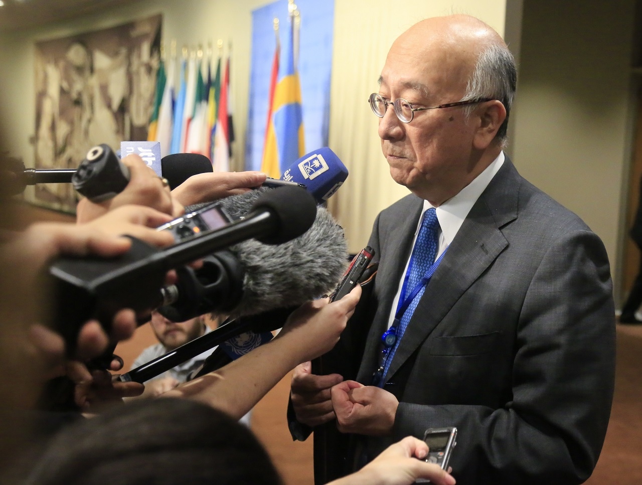 Japan's United Nations Ambassador Koro Bessho speak with reporters before attending U.N. Security Council consultations on North Korea, Tuesday Aug. 29, 2017 at U.N. headquarters.